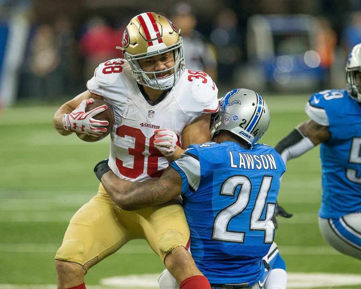 Jarryd Hayne #38 of the San Francisco 49ers tries to break a tackle from Nevin Lawson #24 of the Detroit Lions during an NFL game at Ford Field on December 27, 2015.