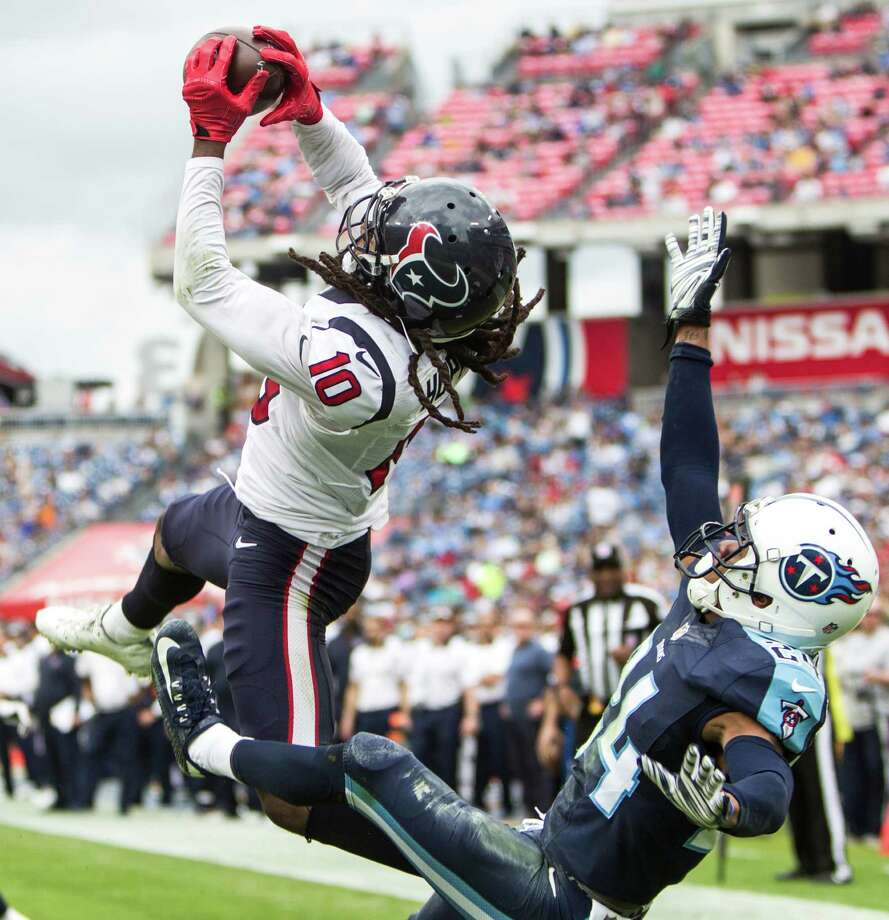 Houston Texans wide receiver DeAndre Hopkins (10) goes up over Tennessee Titans cornerback Coty Sensabaugh (24) to pull down a 15-yard touchdown reception during the third quarter of an NFL football game at Nissan Stadium on Sunday, Dec. 27, 2015, in Nashville. ( Brett Coomer / Houston Chronicle ) Photo: Brett Coomer, Staff / © 2015 Houston Chronicle