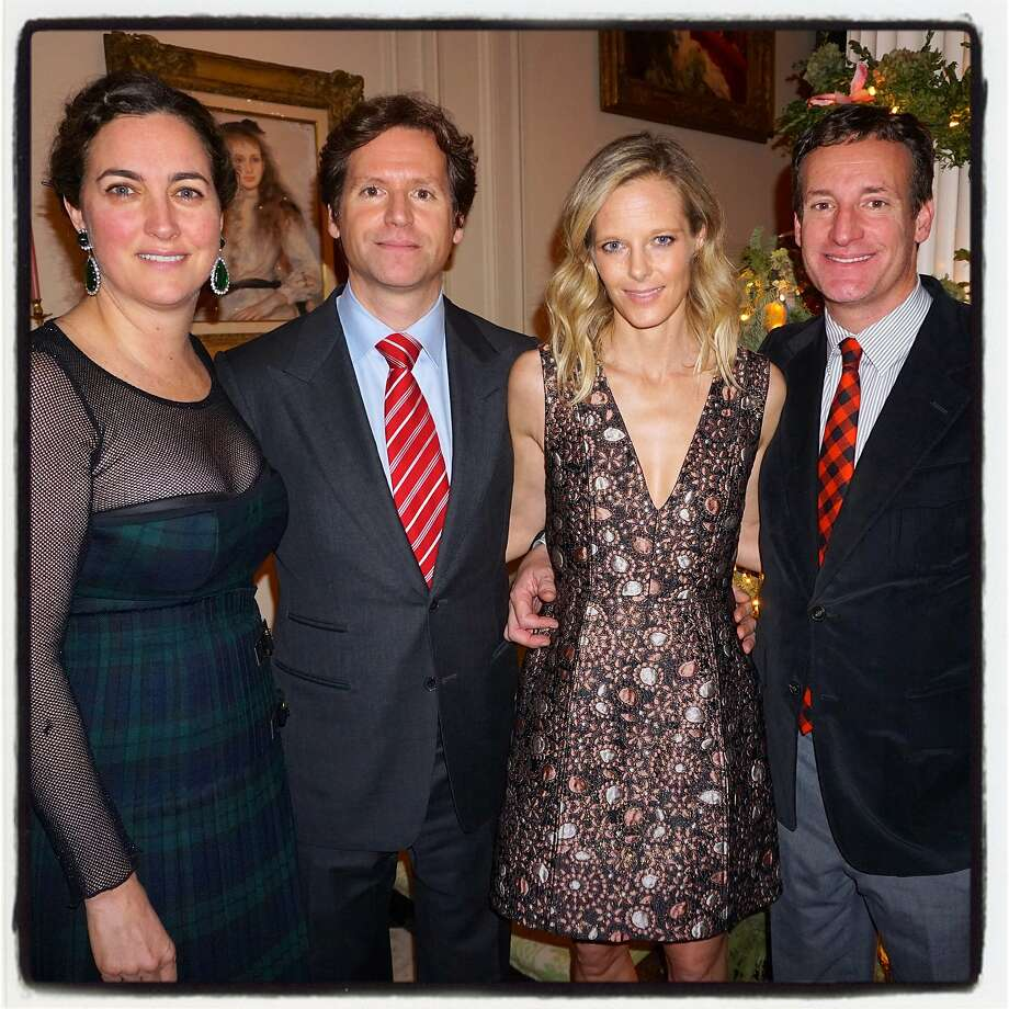 Alexis and Trevor Traina (left) hosted a haute holiday party with Katie and Todd Traina. Photo: Catherine Bigelow, Special To The Chronicle
