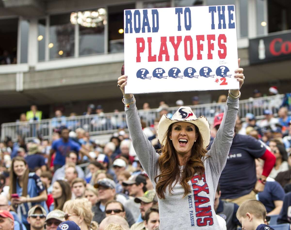 A Houston Texans fan cheers for the Texans during the second quarter of an NFL football game against the Tennessee Titans at Nissan Stadium on Sunday, Dec. 27, 2015, in Nashville. ( Brett Coomer / Houston Chronicle )