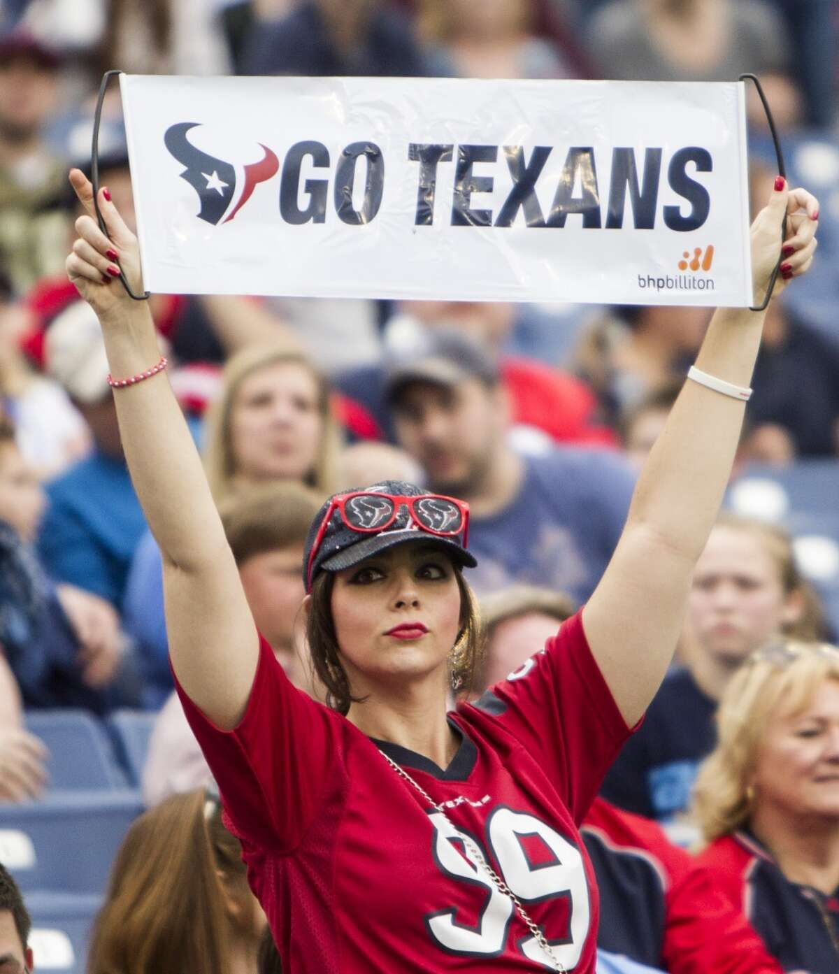 A Houston Texans fans cheers during the fourth quarter of an NFL football game against the Tennessee Titans at Nissan Stadium on Sunday, Dec. 27, 2015, in Nashville. ( Brett Coomer / Houston Chronicle )