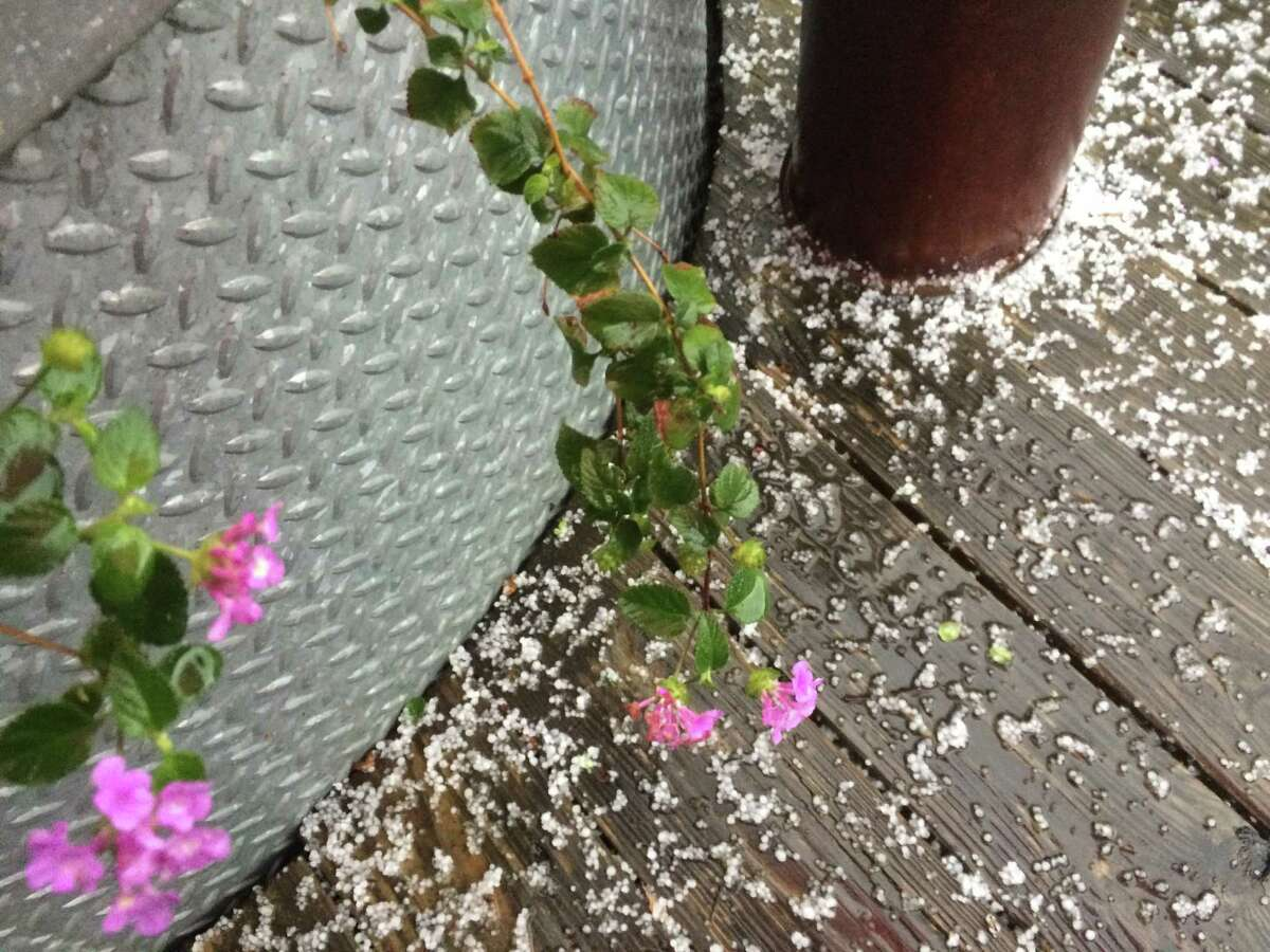 Pea-sized hail fell over parts of San Antonio, including the downtown area, Sunday afternoon, Dec. 27, 2015.