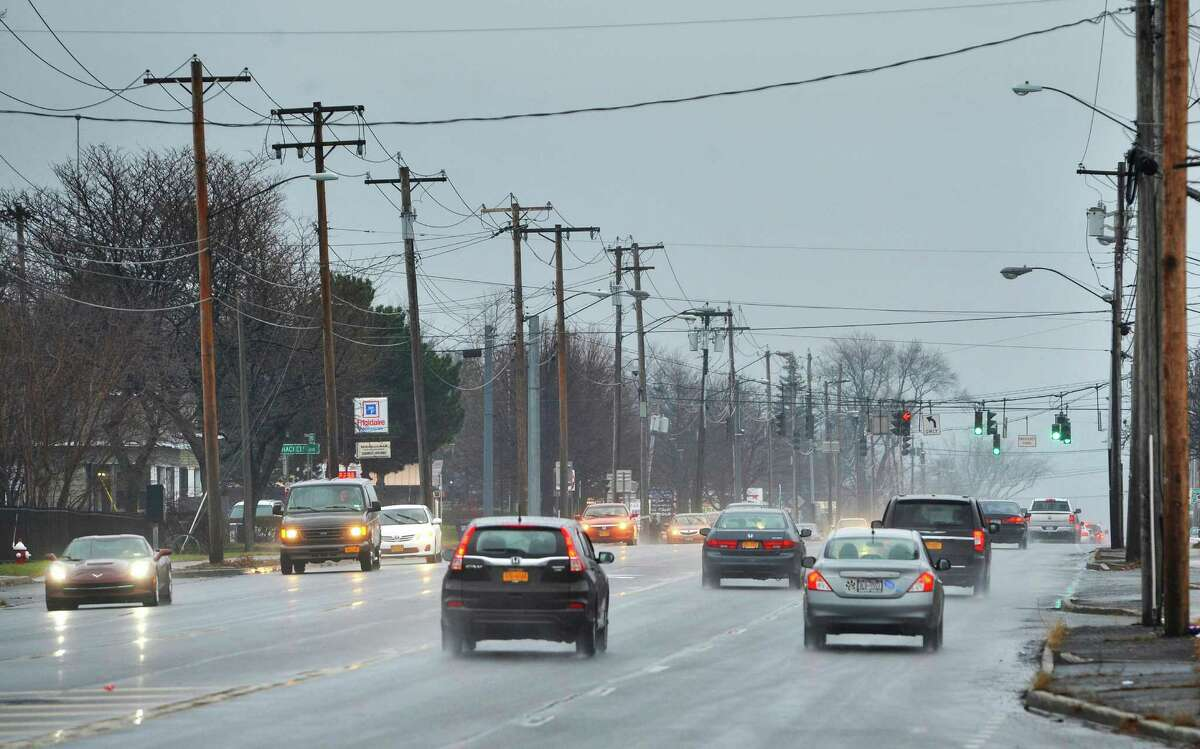 Rain falls on Central Ave. as drivers head east and west along the road on Sunday, Dec. 27, 2015, in Colonie, N.Y. (Paul Buckowski / Times Union)