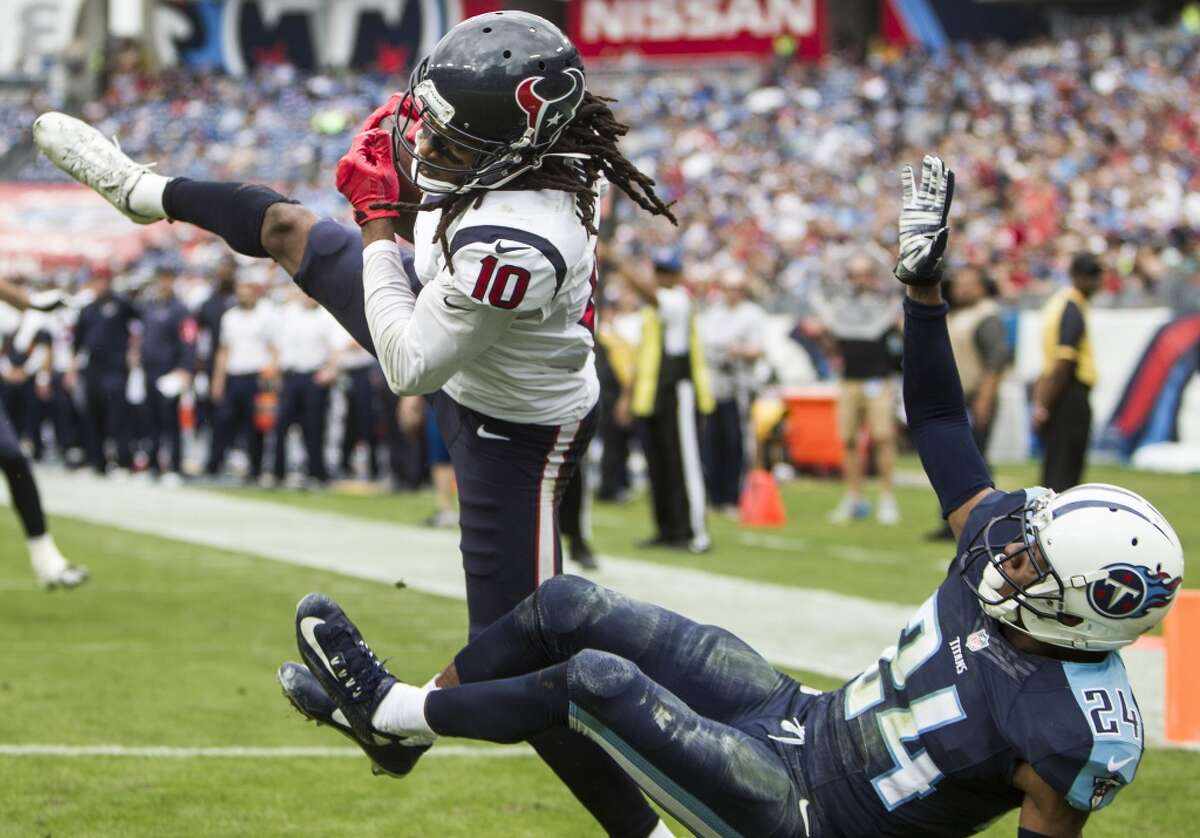Houston Texans wide receiver DeAndre Hopkins (10) goes up over Tennessee Titans cornerback Coty Sensabaugh (24) to pull down a 15-yard touchdown reception during the third quarter of an NFL football game at Nissan Stadium on Sunday, Dec. 27, 2015, in Nashville. ( Brett Coomer / Houston Chronicle )