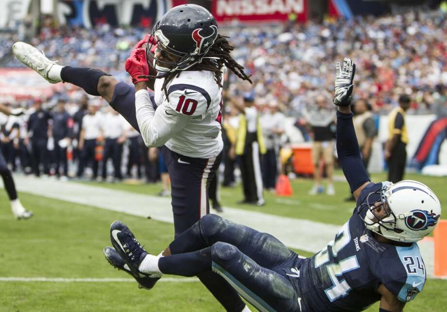 Houston Texans wide receiver DeAndre Hopkins (10) goes up over Tennessee Titans cornerback Coty Sensabaugh (24) to pull down a 15-yard touchdown reception during the third quarter of an NFL football game at Nissan Stadium on Sunday, Dec. 27, 2015, in Nashville. ( Brett Coomer / Houston Chronicle ) Photo: Brett Coomer, Houston Chronicle