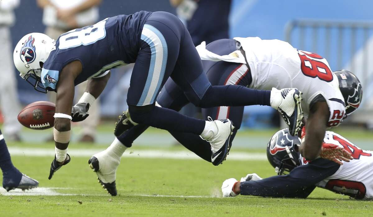 Houston Texans running back Alfred Blue (28) forces Tennessee Titans wide receiver Harry Douglas (83) to fumble on a punt return during the first quarter of an NFL football game at Nissan Stadium on Sunday, Dec. 27, 2015, in Nashville. ( Brett Coomer / Houston Chronicle )