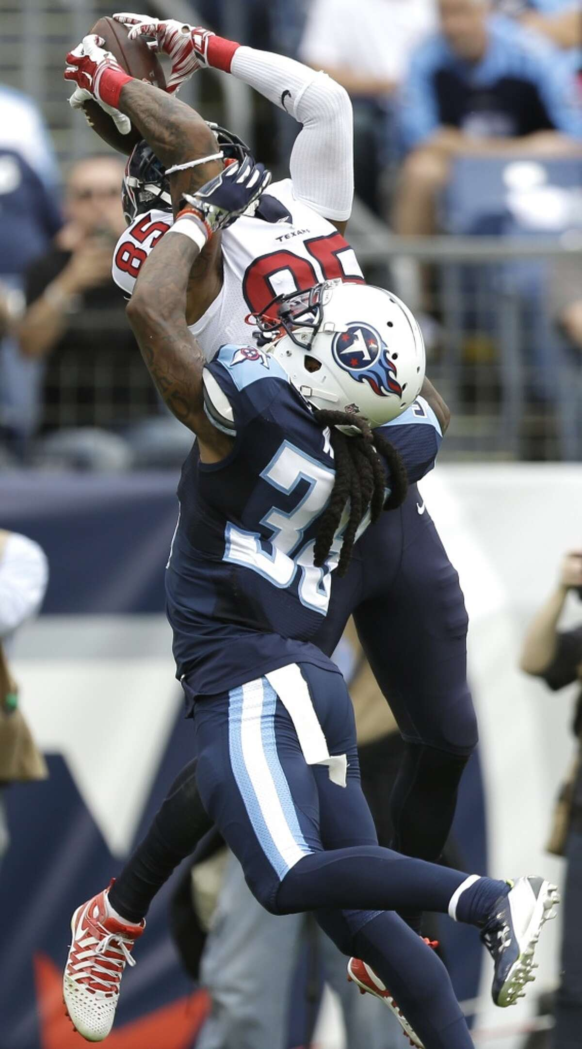 Houston Texans wide receiver Nate Washington (85) goes up over Tennessee Titans defensive back B.W. Webb (38) for a 13-yard touchdown reception during the third quarter of an NFL football game at Nissan Stadium on Sunday, Dec. 27, 2015, in Nashville. ( Brett Coomer / Houston Chronicle )