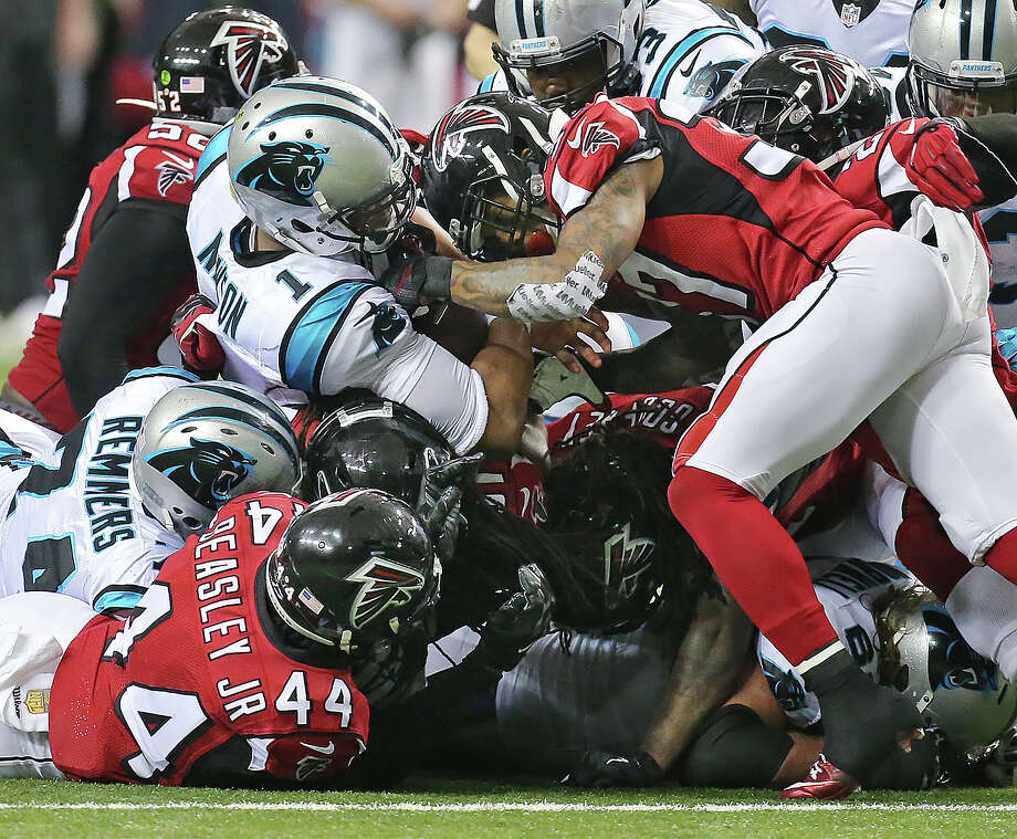 Carolina Panthers Quarterback Cam Newton Is Swarmed By Atlanta Falcons Defenders During The Second Half Of