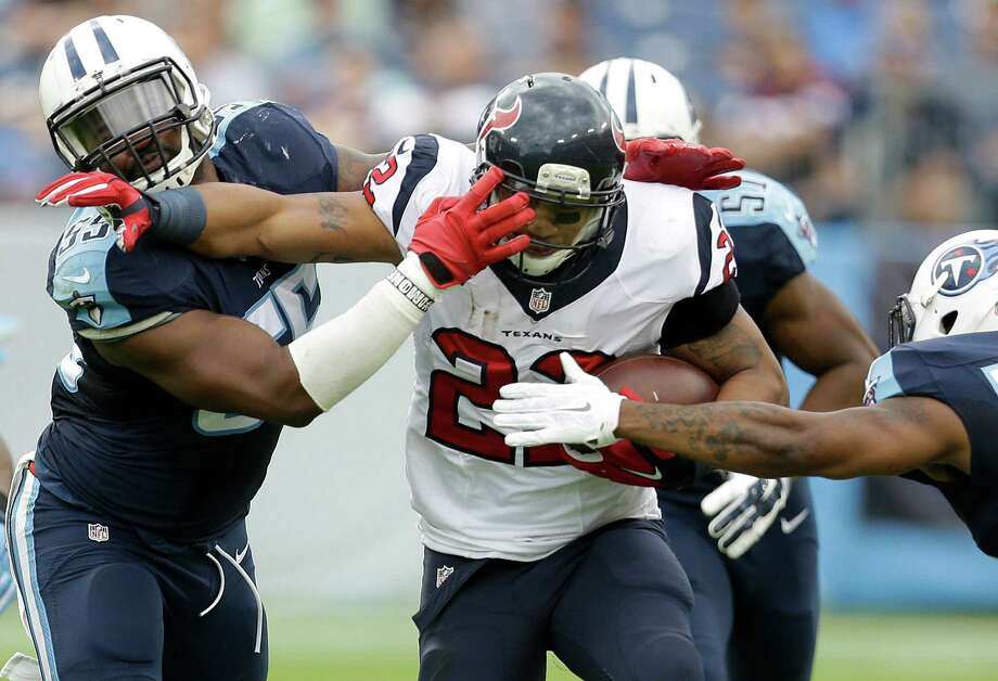Houston Texans running back Chris Polk (22) is hit by Tennessee Titans inside linebacker Zach Brown (55) on a 17-yard gain during the third quarter of an NFL football game at Nissan Stadium on Sunday, Dec. 27, 2015, in Nashville. ( Brett Coomer / Houston Chronicle ) Photo: Brett Coomer, Staff / © 2015 Houston Chronicle