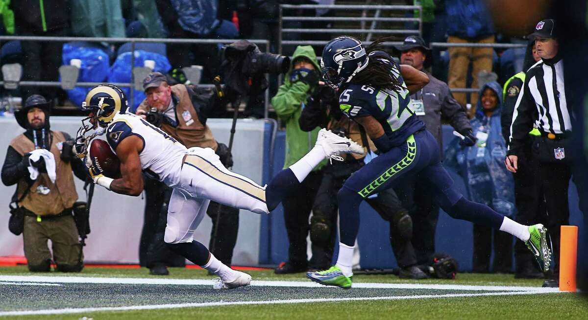Rams wide receiver Kenny Britt snags a pass for a touchdown as Seahawks' Richard Sherman defends (25) during the second quarter of Seattle's game against the St. Louis Rams, Sunday, Dec. 27, 2015 at CenturyLink Field.