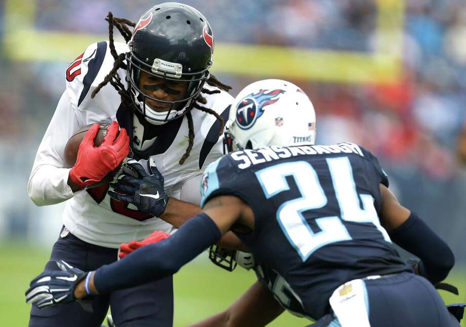 Texans wide receiver DeAndre Hopkins, left, made it a difficult day for Titans cornerback Coty Sensabaugh. Photo: Brett Coomer, Staff / © 2015 Houston Chronicle