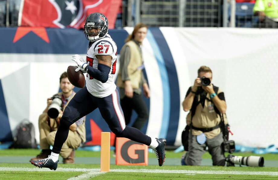 Texans strong safety Quintin Demps strolls into the end zone to complete a 33-yard return of a fumble in the first quarter of Sunday's game. Photo: Brett Coomer, Staff / © 2015 Houston Chronicle