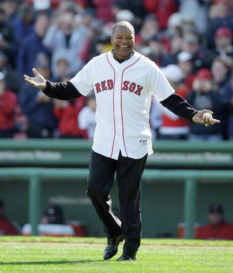 FILE - This Oct. 11, 2009 file photo shows former Boston Red Sox outfielder Dave Henderson walking onto the field to throw out the ceremonial first pitch before Game 3 of an American League baseball division series between the Boston Red Sox and Los Angeles Angels in Boston. Henderson, who hit one of the most famous home runs in postseason history, died Sunday, Dec. 27, 2015, after suffering a massive heart attack. He was 57. (AP Photo/Charles Krupa, file) Photo: Charles Krupa, STF / AP