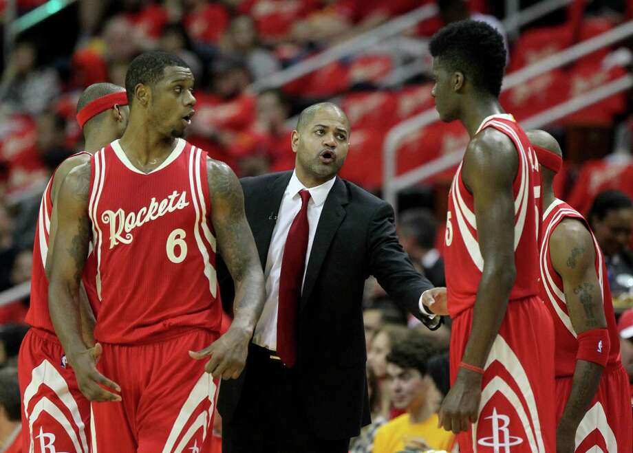 Rockets interim coach J.B. Bickerstaff, center, called out the players after Saturday night's loss to the Pelicans in New Orleans, saying they were more concerned with personal achievements than team wins. Photo: Gary Coronado, Staff / © 2015 Houston Chronicle