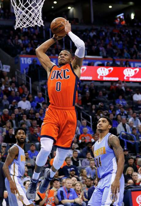 Thunder guard Russell Westbrook goes up to dunk for two of his game-high 30 points in Sunday night's 122-112 victory over the Nuggets in Oklahoma City. Photo: Alonzo Adams, FRE / FR159426 AP