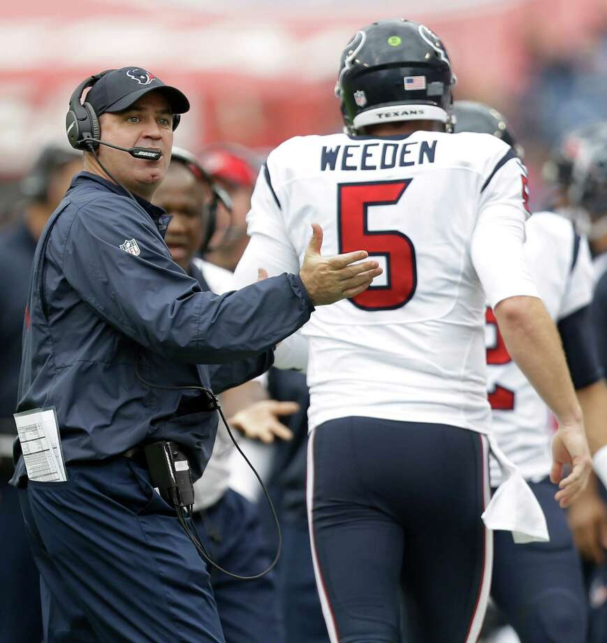 Texans coach Bill O'Brien offers congratulations and encouragement to quarterback Brandon Weeden after Weeden found Nate Washington with a 13-yard touchdown pass in the third quarter Sunday. Photo: Brett Coomer, Staff / © 2015 Houston Chronicle