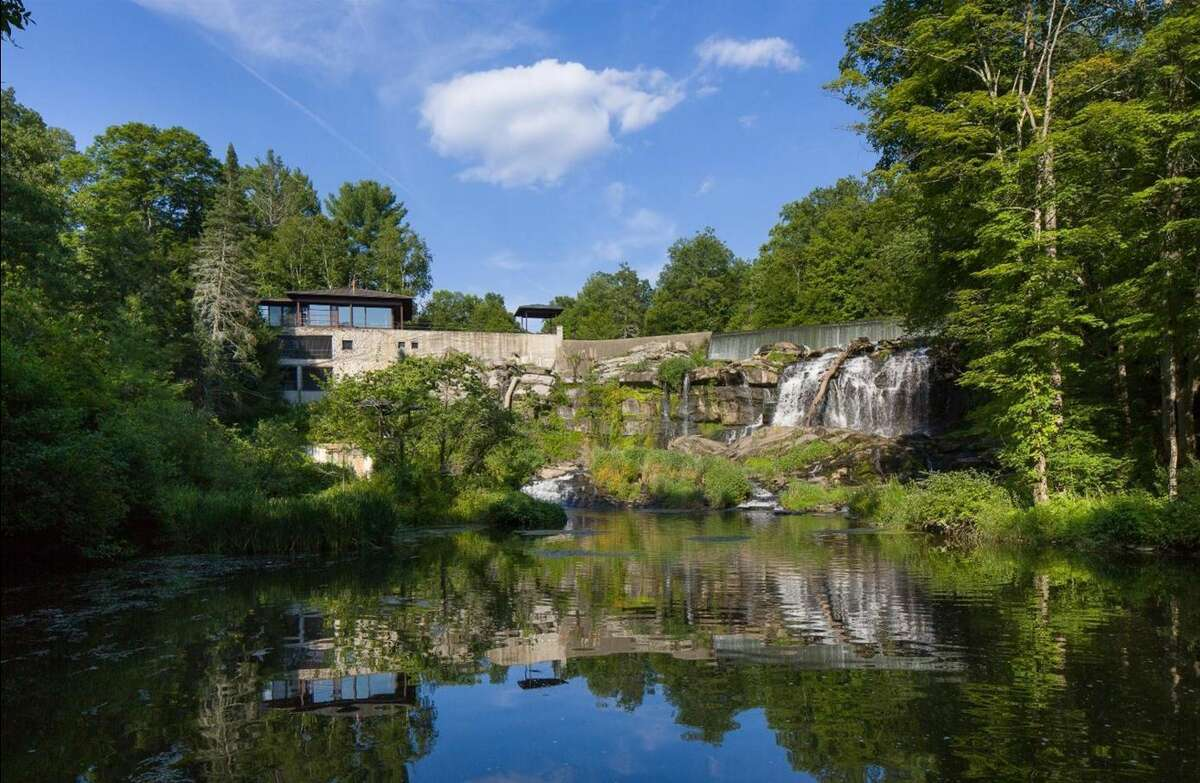 Buttermilk Falls Estate, a 1,482-square-foot home built into the side of a waterfall outside of Rhinebeck, New York, is on the market for more than $8.9 million.