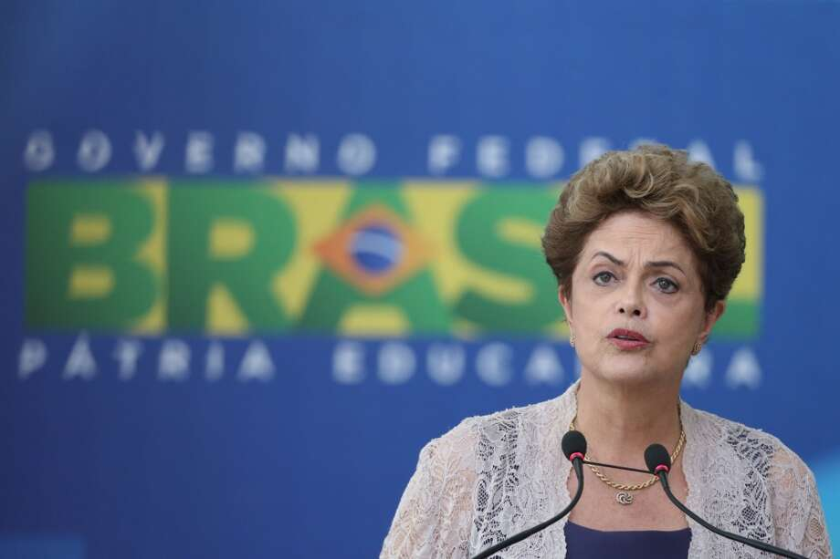 A protest movement in Brazil threatens to oust leftist president Dilma Rousseff. A drop in commodities prices has had ripple effects across Latin America. Photo: Eraldo Peres, Associated Press