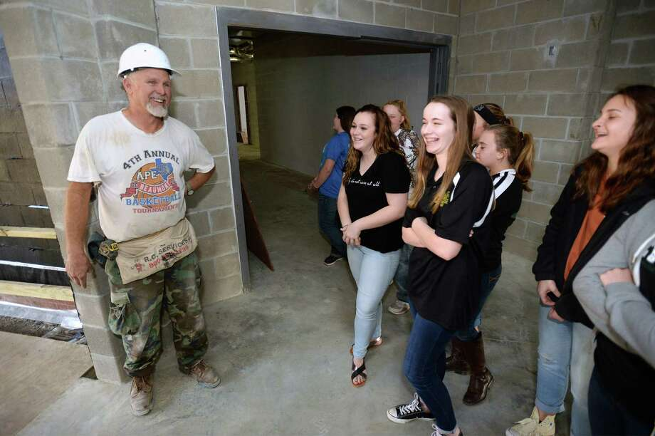 Jeff DeLord talks Wednesday with members of the Little Cypress Junior High's new Interact Club who recently brought food and gifts to the on-campus construction  where workers are building new sections of the school.  Photo taken Wednesday, December 16, 2015 Guiseppe Barranco/The Enterprise Photo: Guiseppe Barranco, Photo Editor