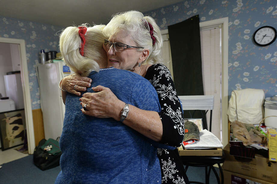 """She just made my childhood so good,"" says an emotional Sandy Nelson, as she hugs life-long friend Cheryl Martin at her home in Silsbee. The pair met the first day of eighth grade, and for Nelson, who struggled with what was years later diagnosed as ADHD and found it difficult to make friends growing up, she knew she had finally found a friend. ""She was so nice to me, and we were both in band, and I really needed a friend,"" Nelson recalls. Decades later, the women have remained best friends and over time have shared some of the brightest and darkest moments of their lives together. After both women lost their husbands, they found themselves back in Hardin County, and Sandy is now not only a friend but caregiver to Cheryl, who is battling the effects of a diabetic condition she has had since childhood. Sandy plans to move Cheryl back into her parents' home, which she and current husband Dave have bought and are remodeling.    Photo taken Thursday, December 10, 2015  Kim Brent/The Enterprise Photo: Kim Brent / Beaumont Enterprise"