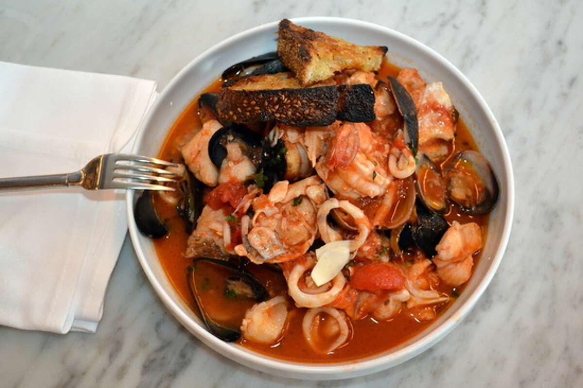 Cioppino: Cioppino (pronounced choh-pee-noh) is an Italian-American fish stew with tomatoes and a variety of fish and shellfish. Region: San Francisco, California