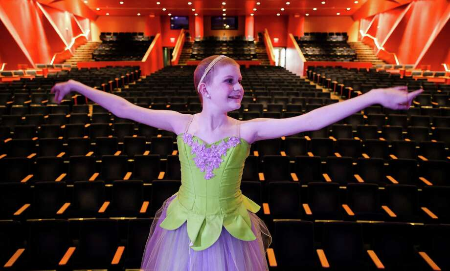 "Peyton Richardson strikes a pose on the Stafford Centre stage before a dress rehearsal of ""The Nutcracker.""  Peyton, 13, has leukemia, but she has not let her childhood cancer keep her from dancing. Photo: Michael Ciaglo, Staff / © 2015  Houston Chronicle"