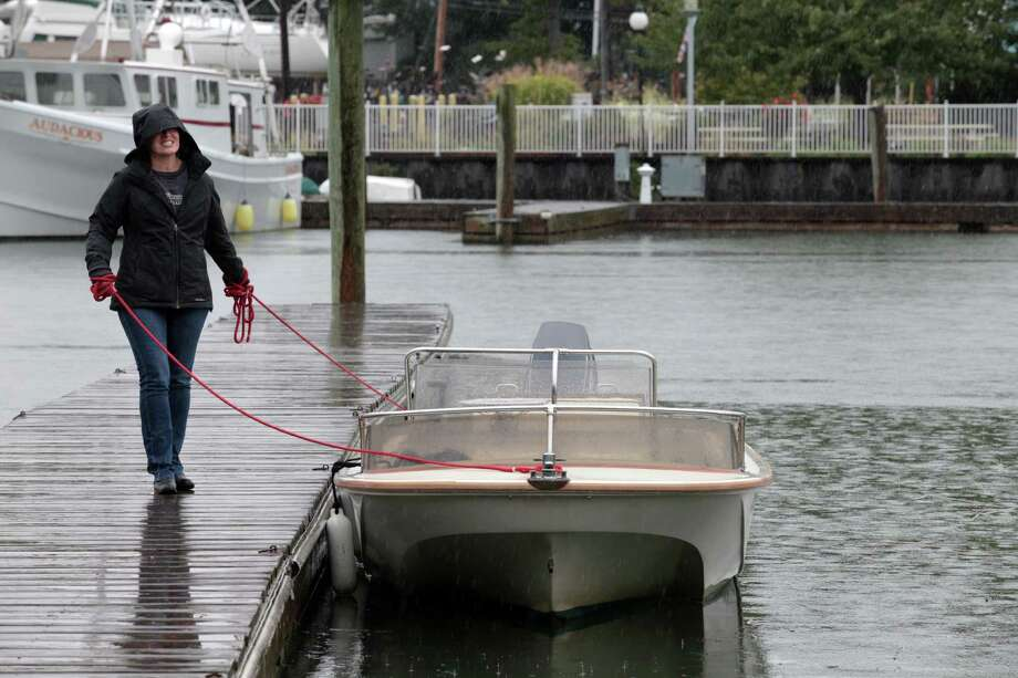 Paula Rusu, of Milford, helps take a boat out Milford Harbor in preparation for this weekend's stormy weather on Friday, October 2, 2015. Photo: BK Angeletti / For Hearst Connecticut Media / Connecticut Post freelance B.K. Angeletti