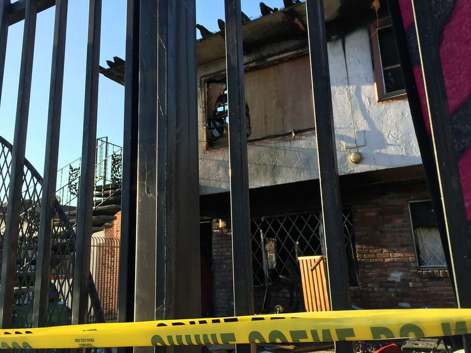Two people died when a fire ripped through an apartment building early Monday morning in the 6200 block of Eastlawn Street in East Oakland. Photo: Kale Williams