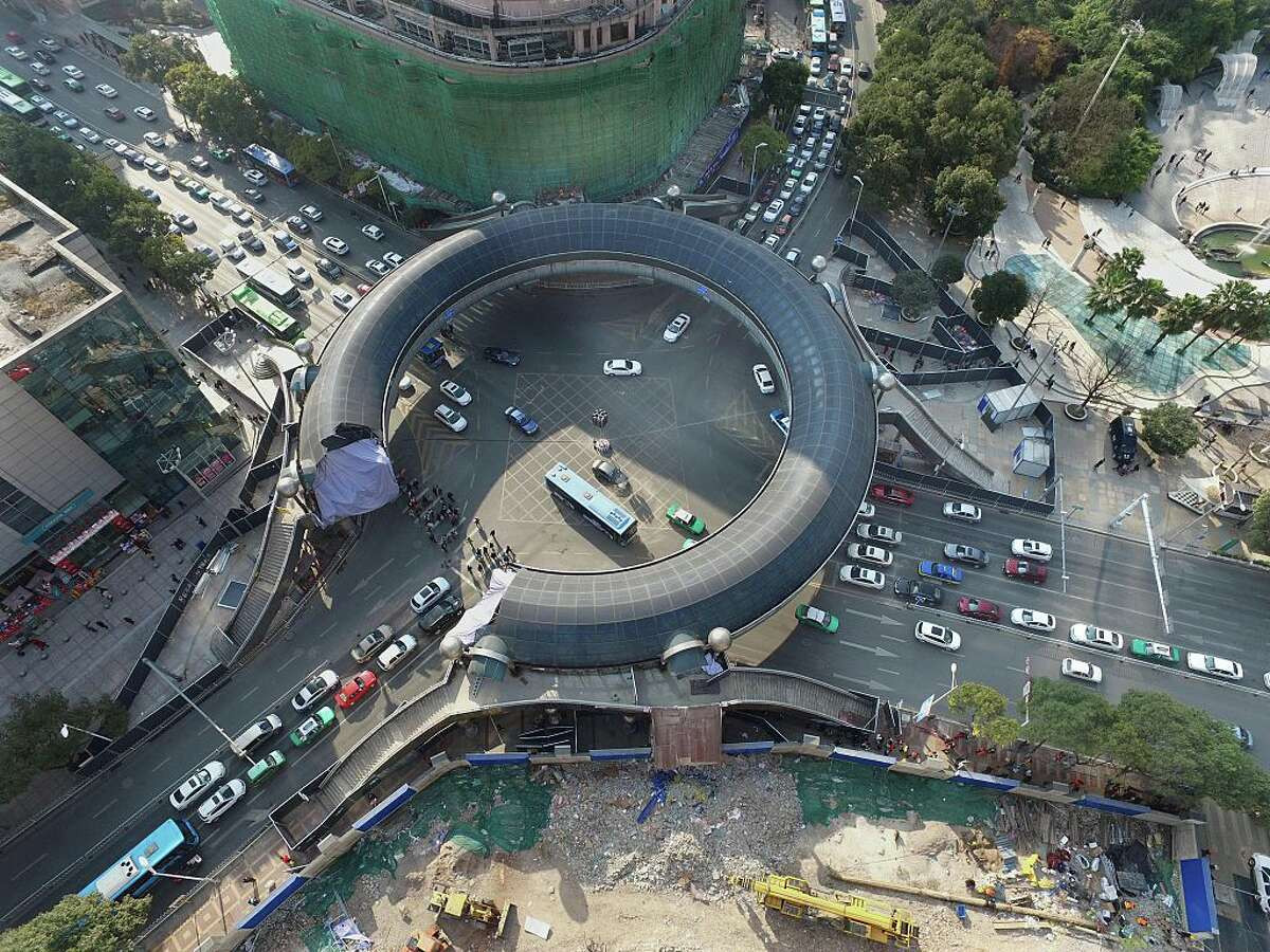 Aerial view of the ring-shaped overpass being demolished on the Heilong River banks on December 27, 2015 in Guiyang, China. The nearly-20-year-old ring-shaped overpass used for people to walk past the streets is to be pulled down and replaced by the underground passages for Guiyang's urban growth.