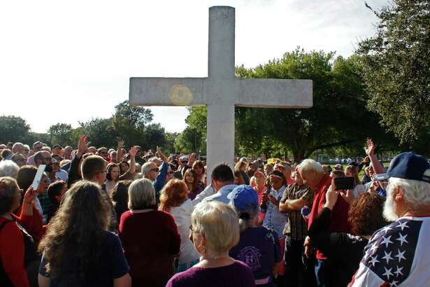 """RELIGIOUS CONTROVERSY: Dozens rallied at Port Neches' Riverfront Park on Nov. 15  after a group called the Freedom from Religion Foundation asked the city to take down a 45-year-old permanent cross display because it violates the """"principle of separation between church and state."""" Photo taken Sunday, November 15, 2015 Michelle Heath/The Enterprise"""