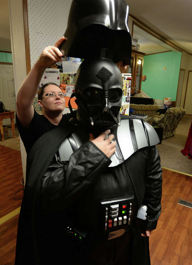 Raina Streeper helps Ben Streeper into his Darth Vador Costume at their Sour Lake Home on Wednesday.   Photo taken Wednesday, November 4, 2015  Guiseppe Barranco/The Enterprise Photo: Guiseppe Barranco, Photo Editor