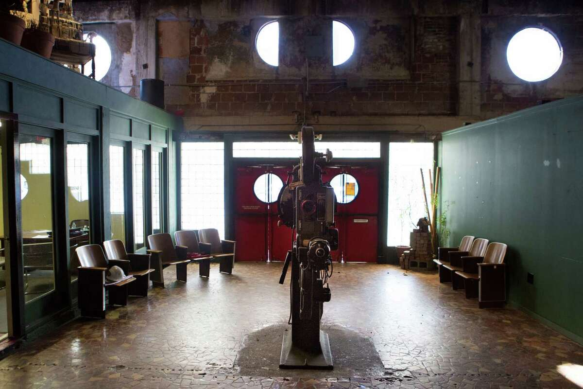 A vintage film projector stands in the middle of the lobby of the Heights theatre which was first built in 1923 as a movie theater, now the 7,058-square-foot building is currently now being renovated as a multi-use entertaiment venue. Friday, Dec. 18, 2015, in Houston. ( Marie D. De Jesus / Houston Chronicle )