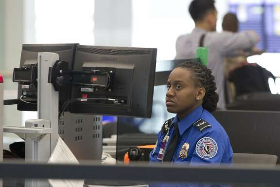 A Transportation Security Administration agent watches a monitor as she scans passengers carry-on luggage at a security checkpoint at the Fort Lauderdale-Hollywood International Airport, Friday, Dec. 18, 2015, in Fort Lauderdale, Fla.  (AP Photo/Wilfredo Lee)