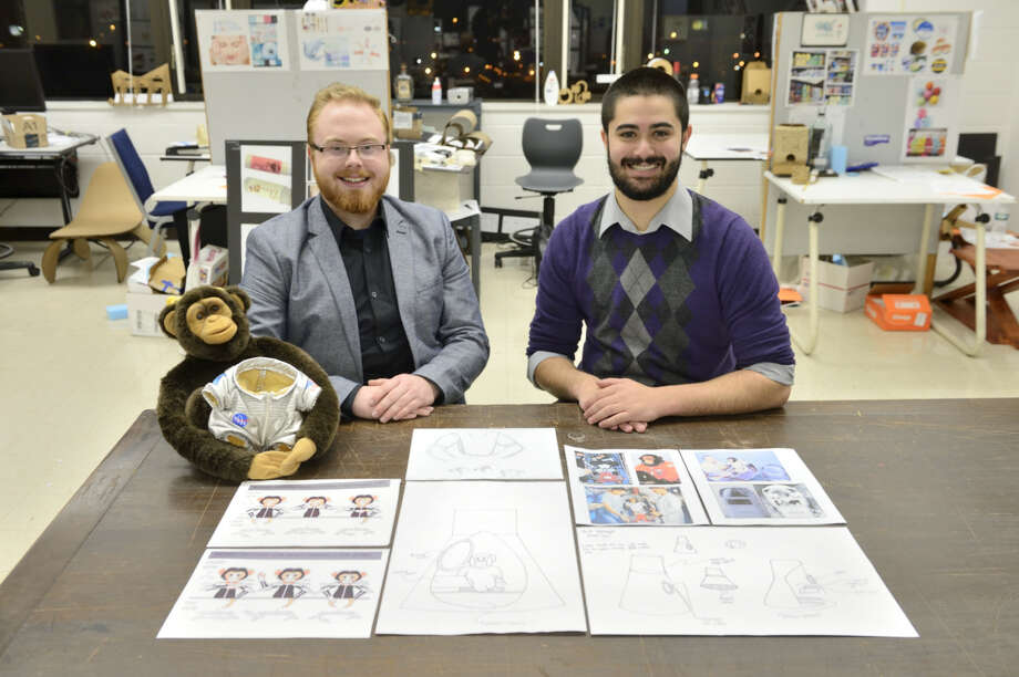 """Phillip Carroll, left, and Joshua Hague, two students awarded scholarships from the Connecticut Space Grant Consortium to further their work in """"Near Space"""" payload structures and robotic movement. The robotic monkey in photo will go up in space and be used to teach kids about space. Launch from Discovery Museum. Kids at museum will get to view space via camera. Photo: / Contributed"""
