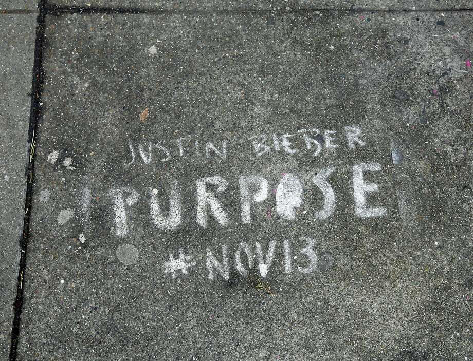 "A spray paint graffiti advertisement for Justin Beiber's new album ""Purpose"" on Howard Street between Sixth and Seventh streets in San Francisco, California, on Monday, Dec. 28, 2015. Photo: Connor Radnovich, The Chronicle"