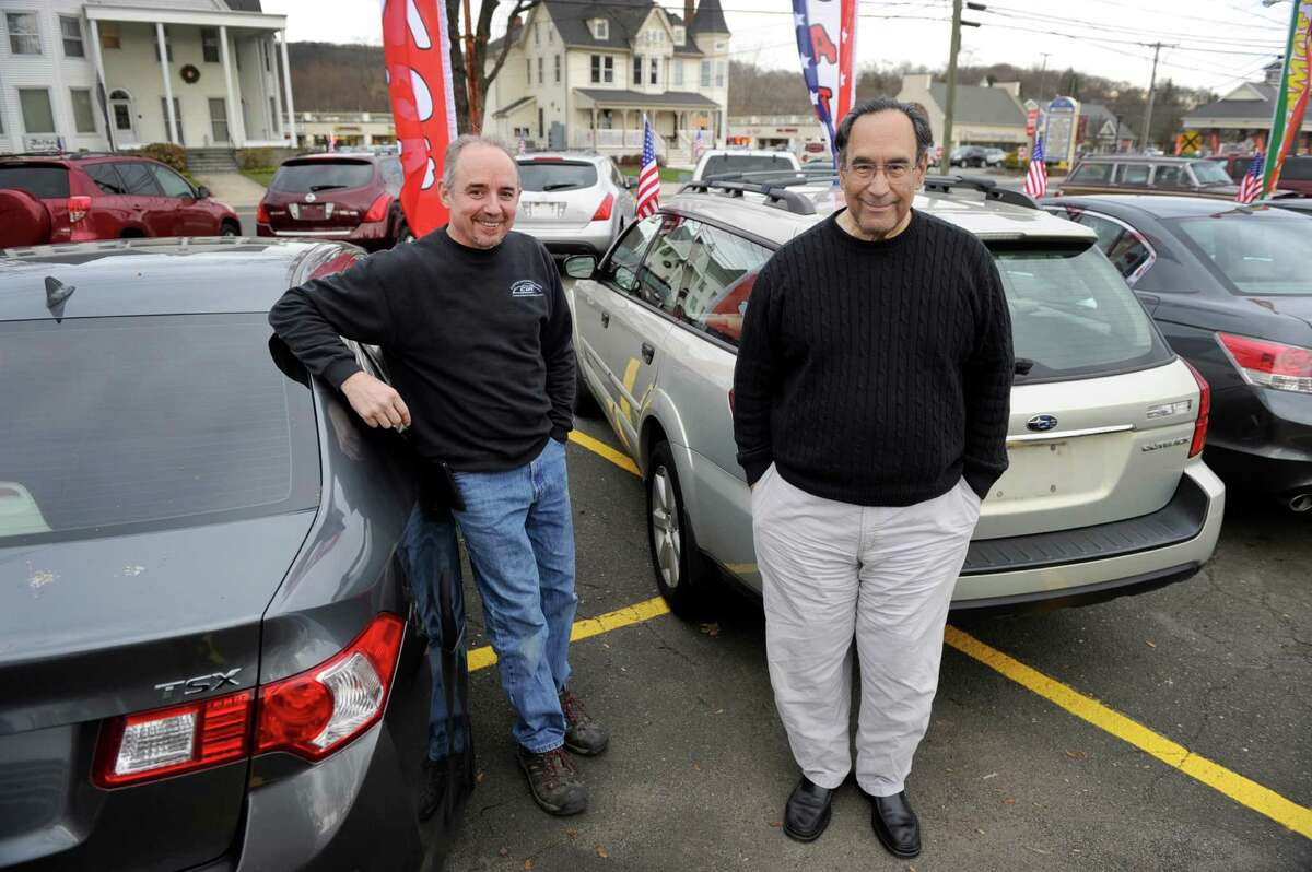 Bryan Kendall, left, of Brookfield, and Charlie Hernandez, of Danbury, are partners in Nice Ride Auto Sales in Bethel, Conn. Photo Monday, Dec. 28, 2015