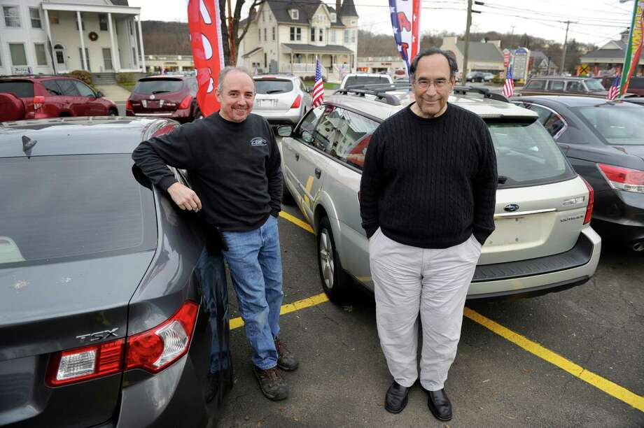 Bryan Kendall, left, of Brookfield, and Charlie Hernandez, of Danbury, are partners in Nice Ride Auto Sales in Bethel, Conn. Photo Monday, Dec. 28, 2015 Photo: Carol Kaliff / Hearst Connecticut Media / The News-Times