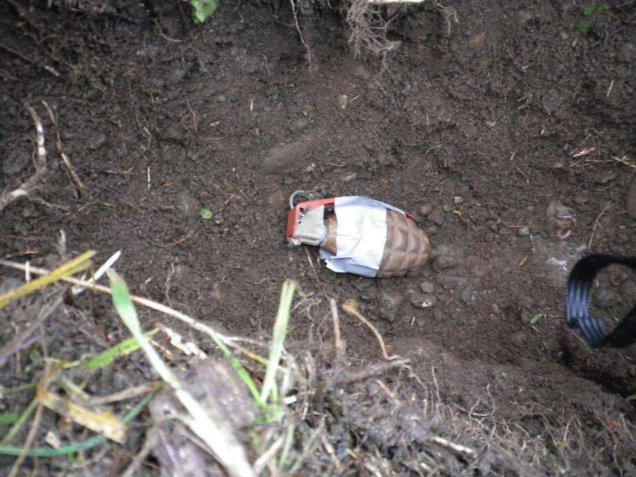 A construction worker found a box containing this grenade in SeaTac Monday, prompting the King County Sheriff's Office and FBI bomb technicians to respond and examine the device. They performed an X-ray on the grenade in an attempt to detect explosive material. Photo: King County Sheriff's Office