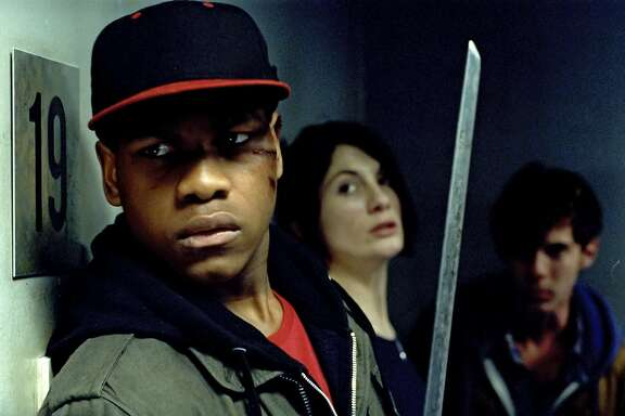 (l to r) John Boyega as Moses, Jodie Whittaker as Sam and Luke Treadaway as Brewis in Screen Gems' ATTACK THE BLOCK.
