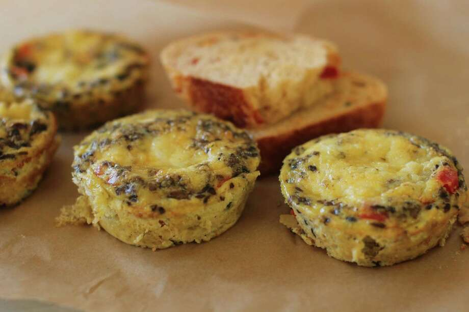 This Nov. 9, 2015 photo shows southwestern mini frittatas in Concord, NH. A frittata is an Italian omelet, but one in which all of the add-ins (cheese, veggies, meat, rice, what have you) are mixed directly into the eggs (rather than folded into the center). (AP Photo/Matthew Mead) Photo: Matthew Mead, FRE / FR170582 AP