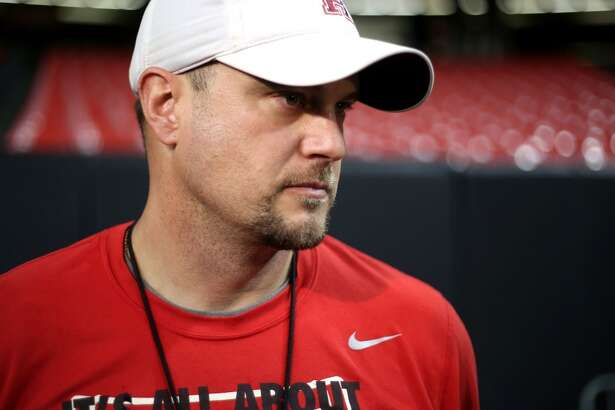 Houston Cougars head coach Tom Herman talks to reporters after Monday's practice at the Georgia Dome on Monday, Dec. 28, 2015, in Atlanta. ( Elizabeth Conley / Houston Chronicle )