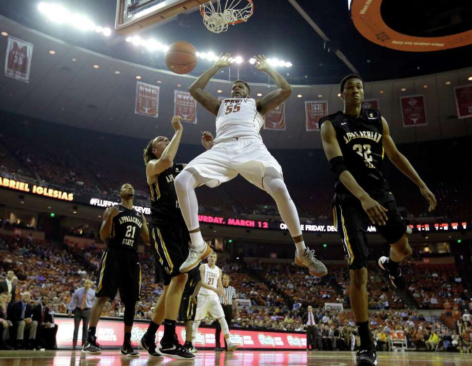 Texas center Cameron Ridley (55) dunces over Appalachian State forward Tyrell Johnson (32) during the second half of an NCAA college basketball game, Tuesday, Dec. 15, 2015, in Austin, Texas. (AP Photo/Eric Gay) Photo: Eric Gay, STF / Associated Press / AP