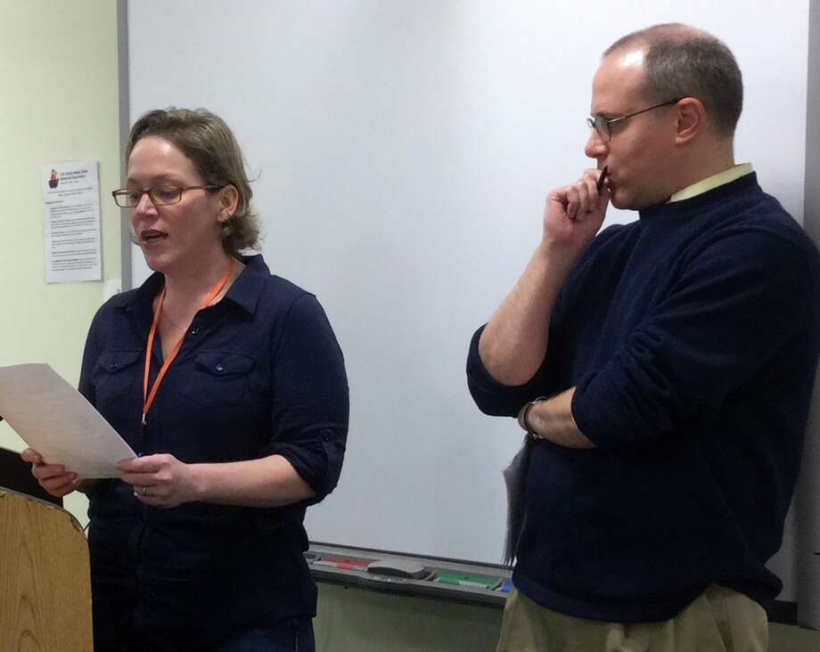 Kristin and Alex Zisson speak at a Board of Education meeting Dec. 17 at Greenwich High School. Photo: Paul Schott