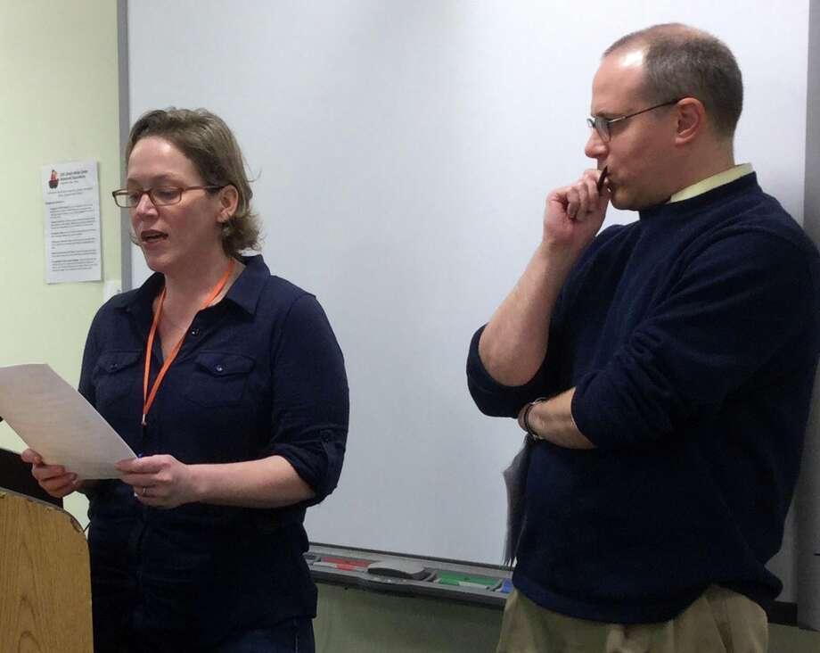 Kristin and Alex Zisson speak at a Board of Education meeting Dec. 17 at Greenwich High School. Photo: Paul Schott