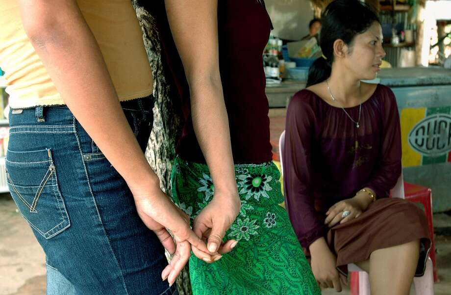 Young prostitutes at a brothel in Koh Kong (near the Thai border) where a lot of young women are forced into prostitution and trafficked to neighboring Thailand. The brothel here is being visited by Somaly Mam, a 34-year old Cambodian founder and president of Acting for Women in Distressing Situations, an international NGO combatting trafficking in women and children for sex slavery. Photo: Thierry Falise