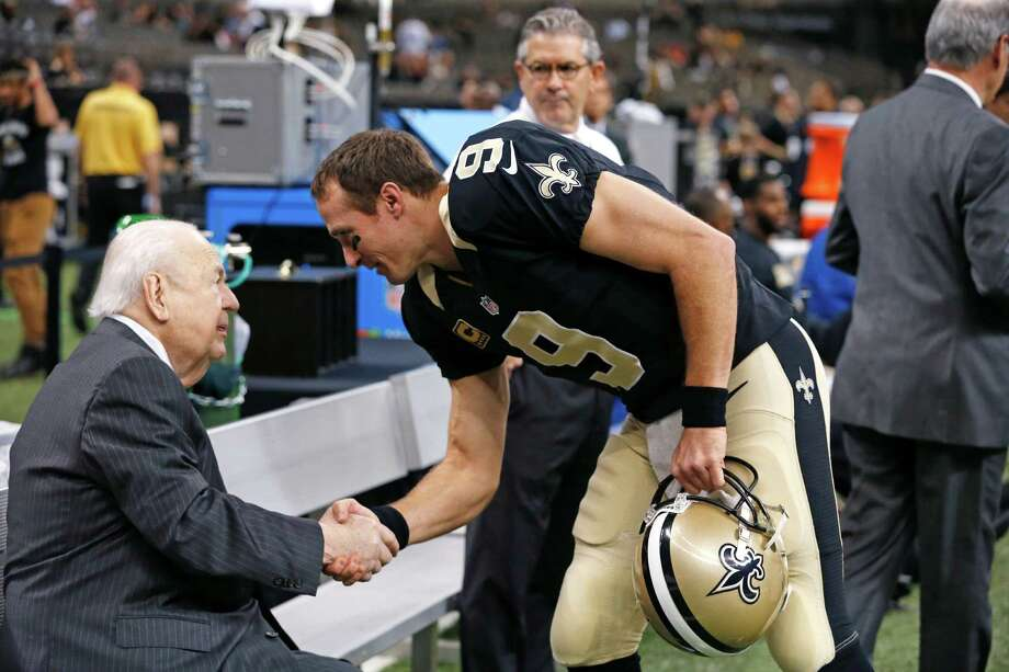 New Orleans Saints quarterback Drew Brees shakes hands with team owner Tom Benson before Sunday's game against the Jacksonville Jaguars in New Orleans. Photo: Jonathan Bachman /Associated Press / FR170615 AP