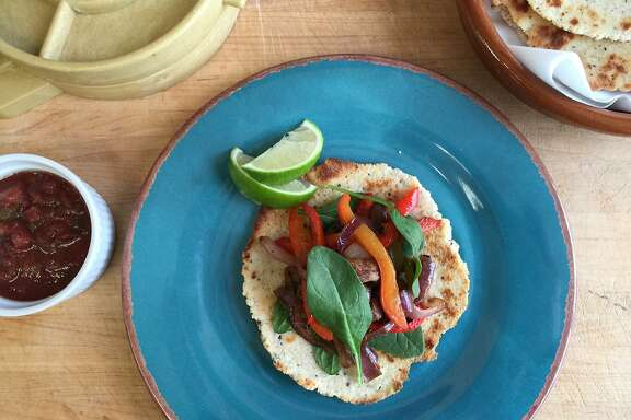 Steak, peppers and onions top almond-flax tostadas