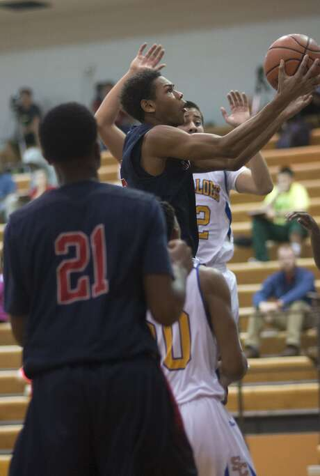 Sophomore guard De'Andre Johnson, center, helped Cypress Springs to a 9-4 record. Photo: Jerry Baker, Freelance