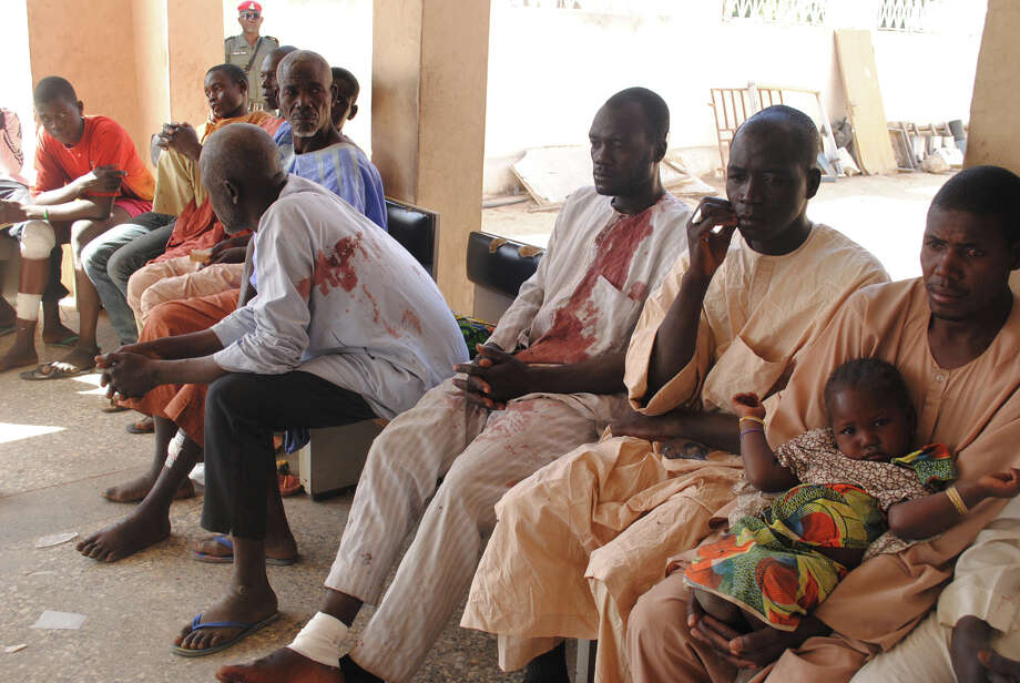 Victims of a Boko Haram attack wait for  treatment at a hospital in Maiduguri, Nigeria Monday, Dec. 28, 2015. Boko Haram Islamic extremists struck the northeastern Nigerian city of Maiduguri for the first time in months Monday with rocket-propelled grenades and multiple suicide bombers, witnesses said. At least 50 people were killed and the death toll could go higher. (AP Photo/Jossy Ola) Photo: Jossy Ola, STR / AP
