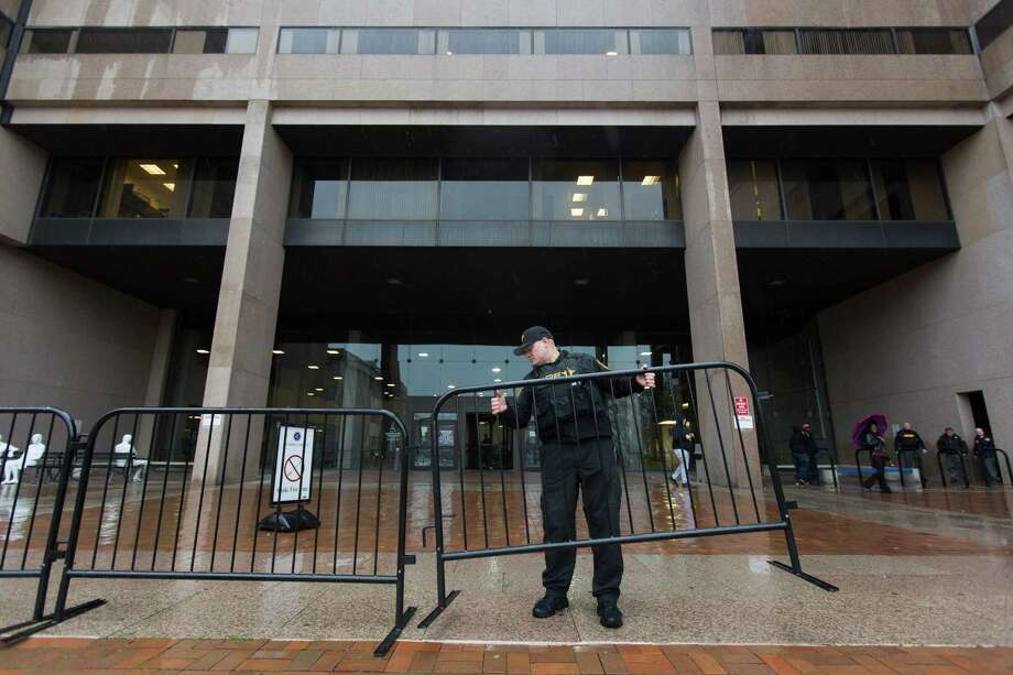 An officer puts up barricades at the Cleveland justice center before the grand jury's decision not to indict a patrolman and his partner. Photo: Alex Slitz /New York Times / NYTNS